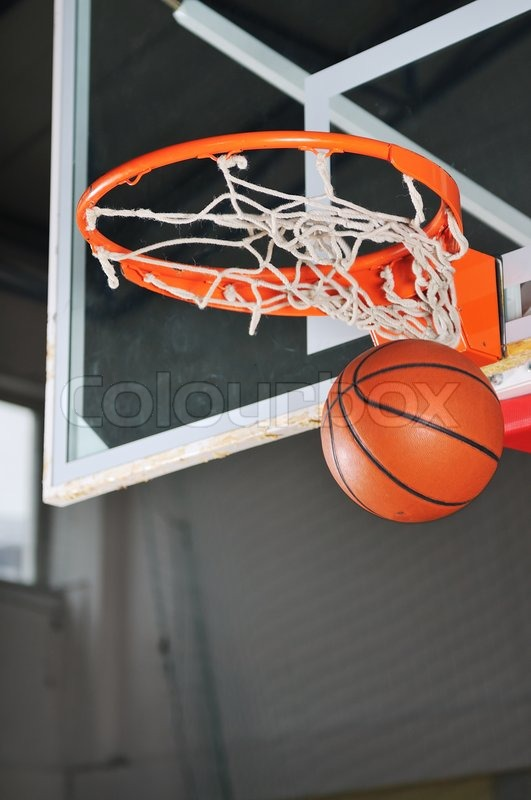 Oreange basket ball in basketball basket, stock photo