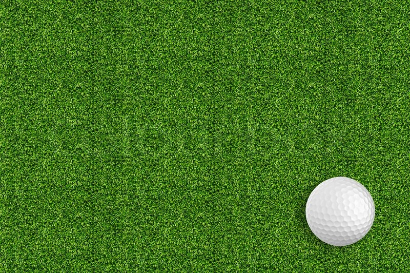 Golf ball on the green grass of the golf course, stock photo