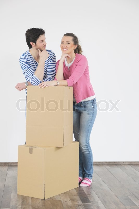 Happy Young couple moving in new home, stock photo