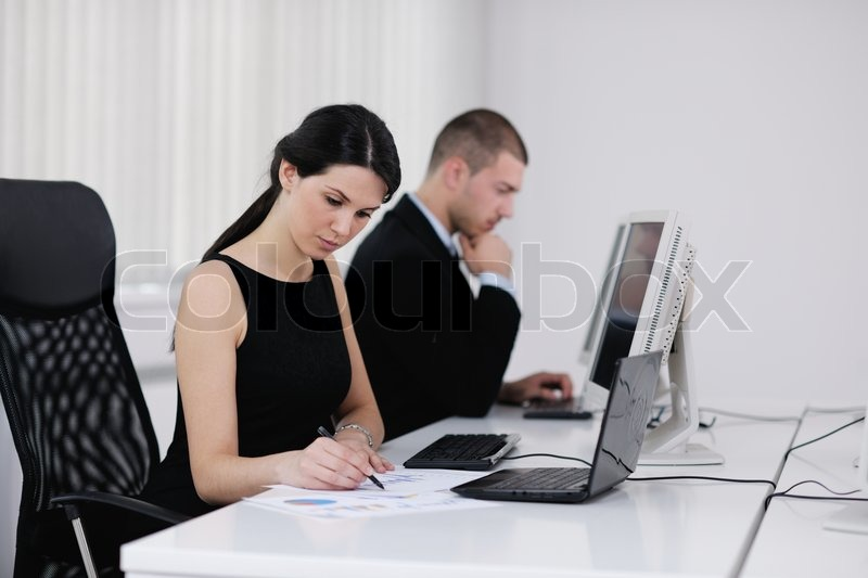 Business people group with headphones giving support in help desk office to customers, manager giving training and education instructions, stock photo
