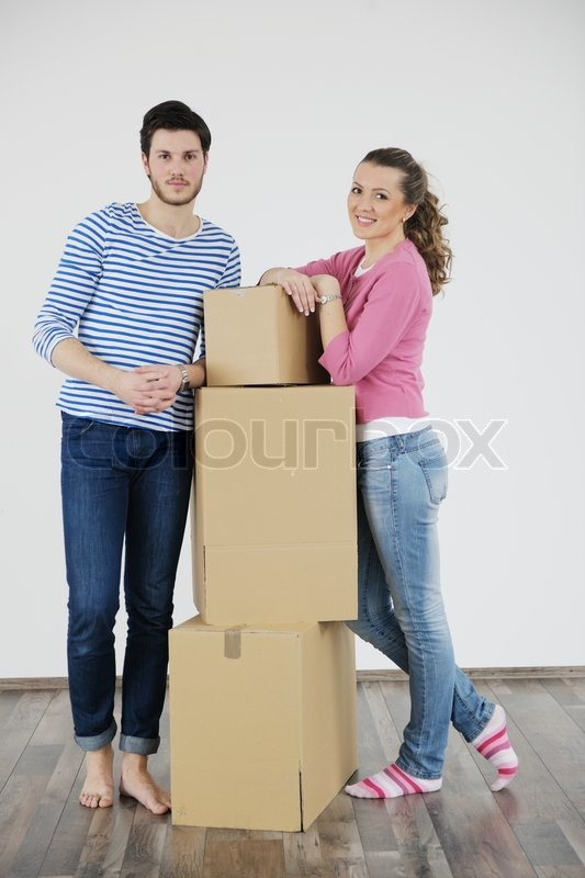 Happy Young couple moving in new house, stock photo
