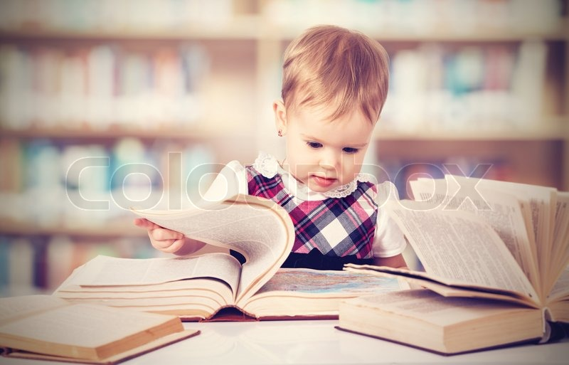 Happy Cute Baby Girl Reading A Book In Stock Image