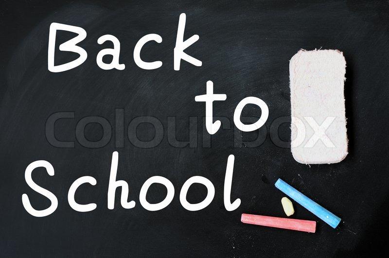school blackboard or chalkboard blank with eraser and chalk