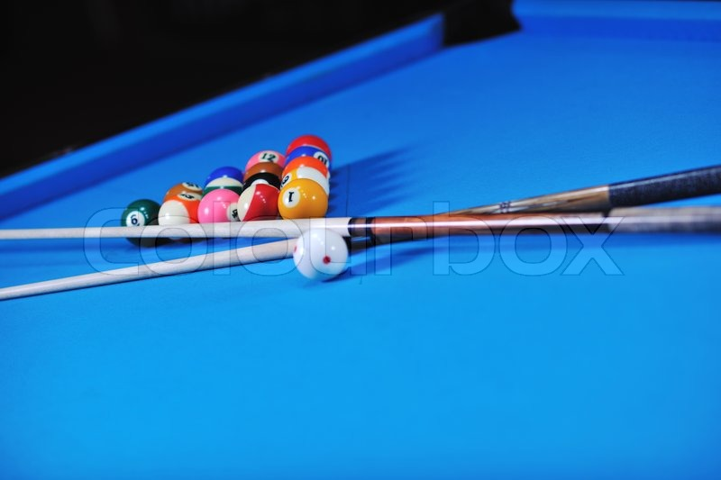 Stock image of balls for playing pool on a billiard table focus in