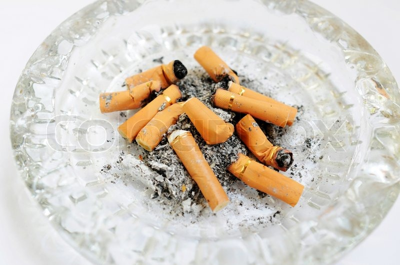 Stock image of 'An ashtray filled with cigarette butts'