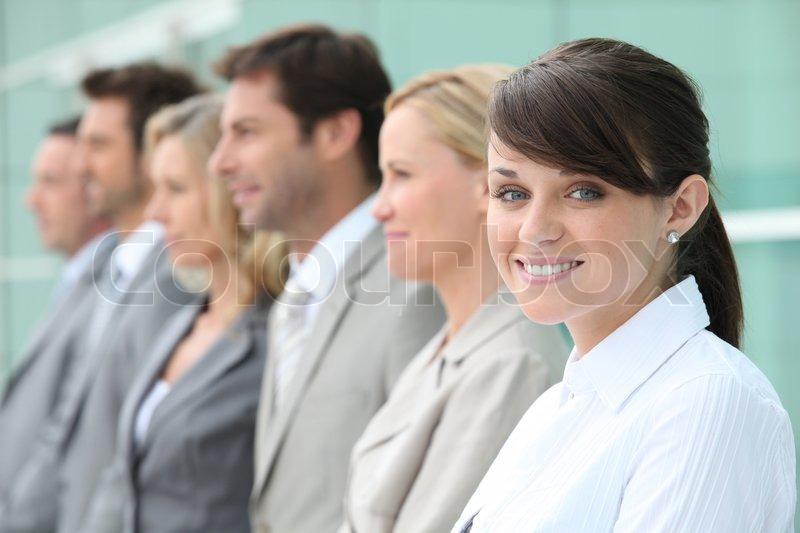 Line up of employees with the youngest in focus, stock photo