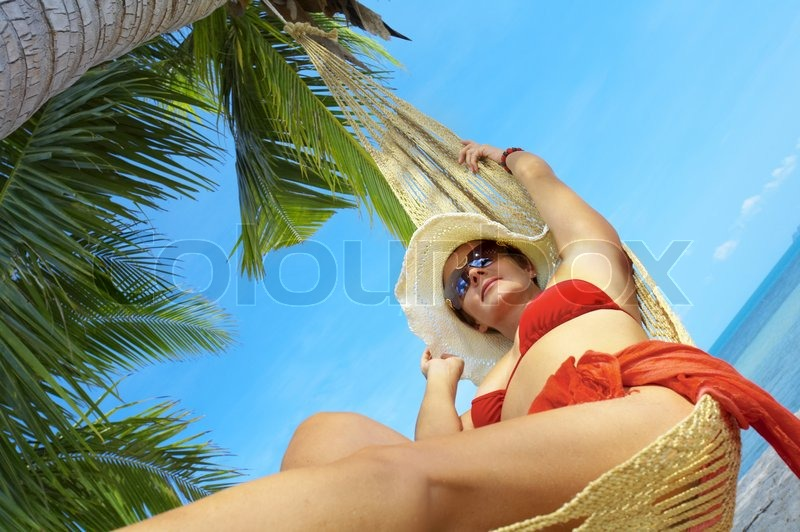 View of nice woman lounging in hammock in tropical environment stock photo colourbox - Impressive house with tranquil environment to get total relaxation ...
