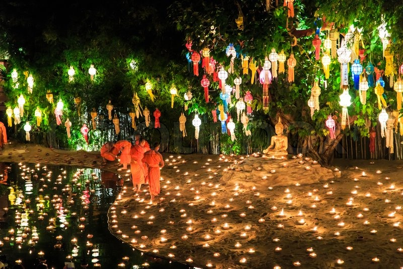 CHIANG MAI THAILAND-NOVEMBER 17 : Loy Krathong festival in Chiangmai.Tradition al monk Lights floating balloon made of paper annually at Wat Phan Tao temple.on November 17,2013 in Chiangmai,Thailand, stock photo