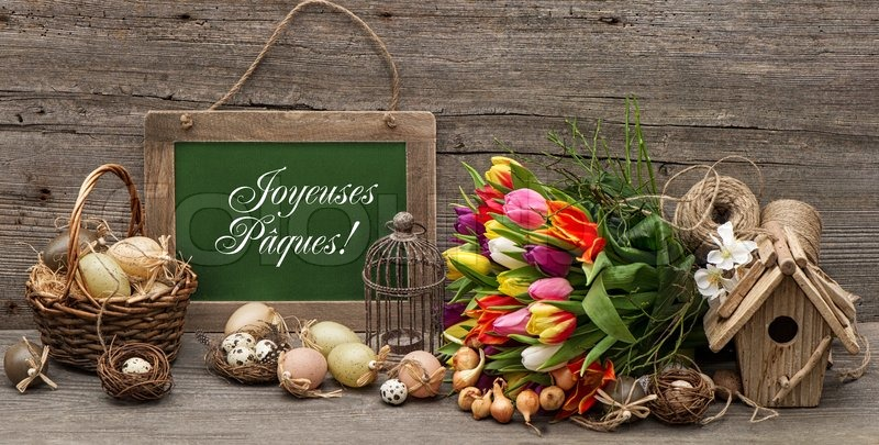 Stock image of vintage easter decoration with eggs and tulip flowers ...