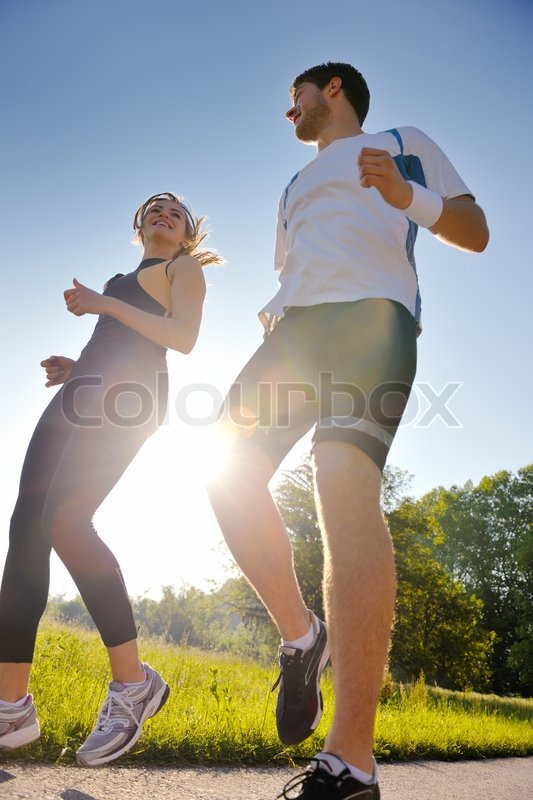 Young couple jogging in park at morning. Health and fitness, stock photo
