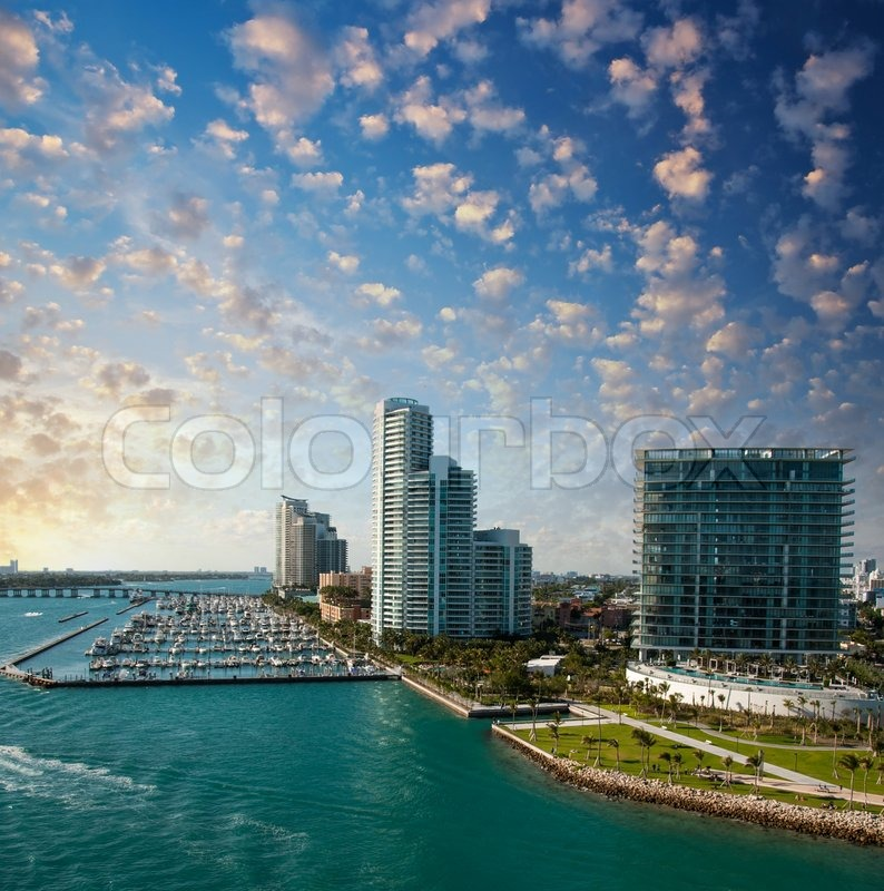 Stock image of 'Skyline of Miami. Beautiful buildings near the ocean.'