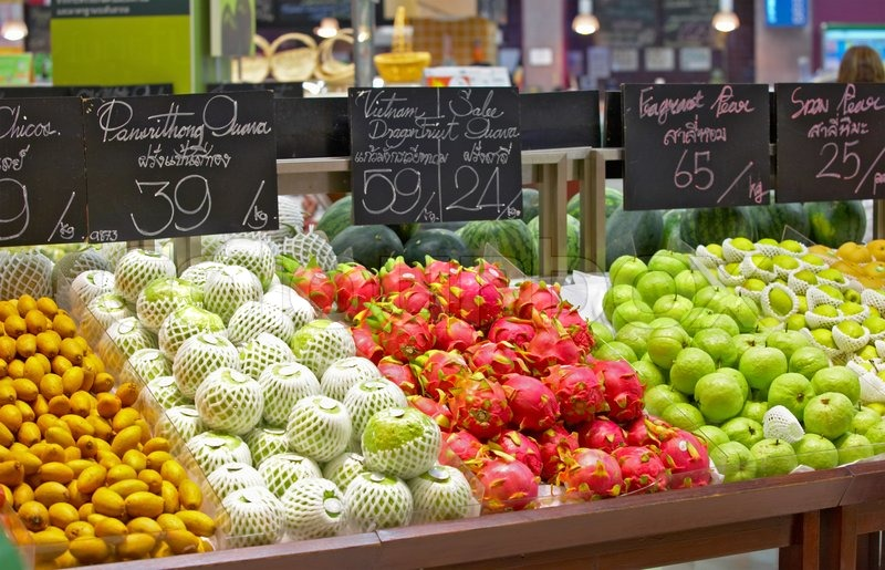 Stock image of 'view of supermarket showcase full of nice tropical fruits'