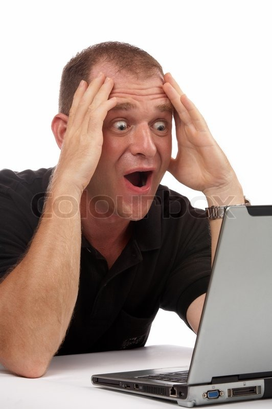 Stock image of 'view of a businessman having some exciting news on the screen of his computer'