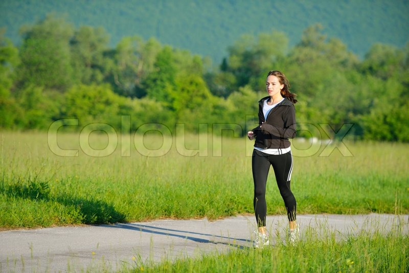 Stock image of 'Young couple jogging in park at morning. Health and fitness.'