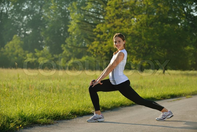 Stock image of 'healthy young woman stretching before Fitness and Exercise'