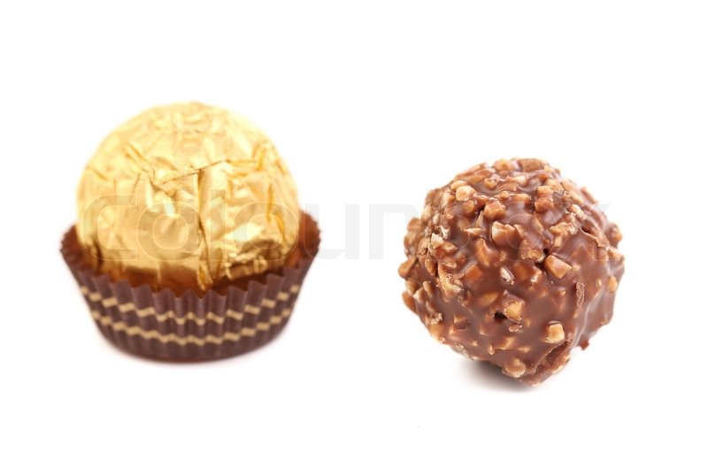 Stock image of 'Sweet chocolate candies. Isolated on a white background.'