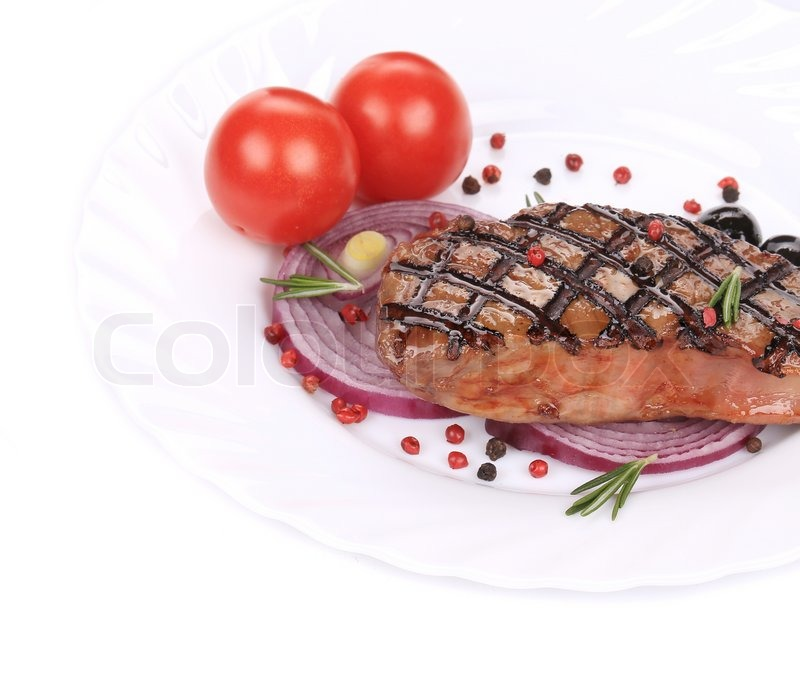 Stock image of 'beef steaks with vegetables. Isolated on a white background.'