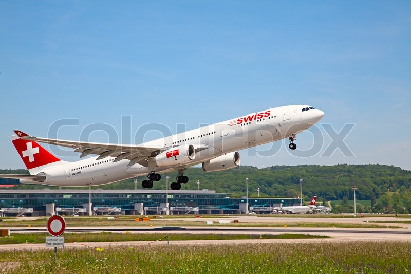 Editorial image of 'ZURICH - MAY 24: A-340 leaving Zurich airport for intercontinental flight on May 24, 2010 in Zurich, Switzerland. Zurich airport is home port for Swiss Air and one of the biggest european hubs.'