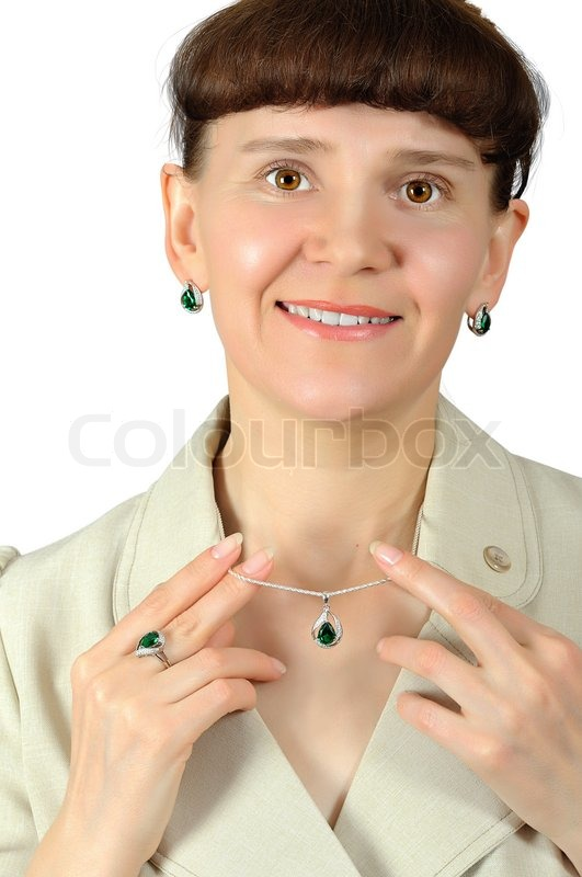 Stock image of 'Happy woman holding fingers emerald pendant with chain'