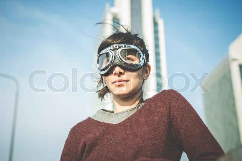 Stock image of 'young beautiful hipster woman success aviator glasses  in the city'