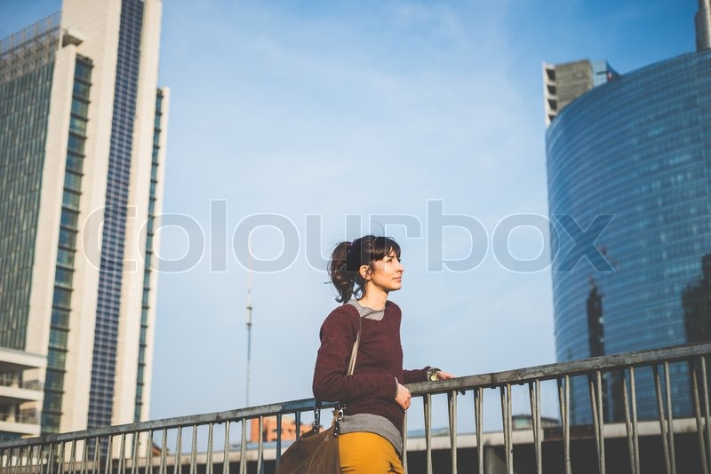 Stock image of 'young beautiful hipster woman in the city'