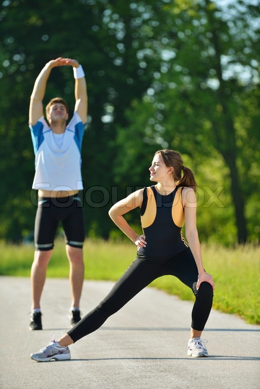 Stock image of 'young health couple doing stretching exercise relaxing and warm up after jogging and running in park'
