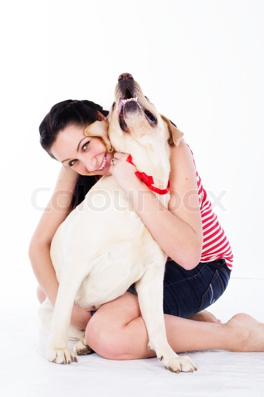 Stock image of 'happy smiling girl with her dog labrador isolated on white background'