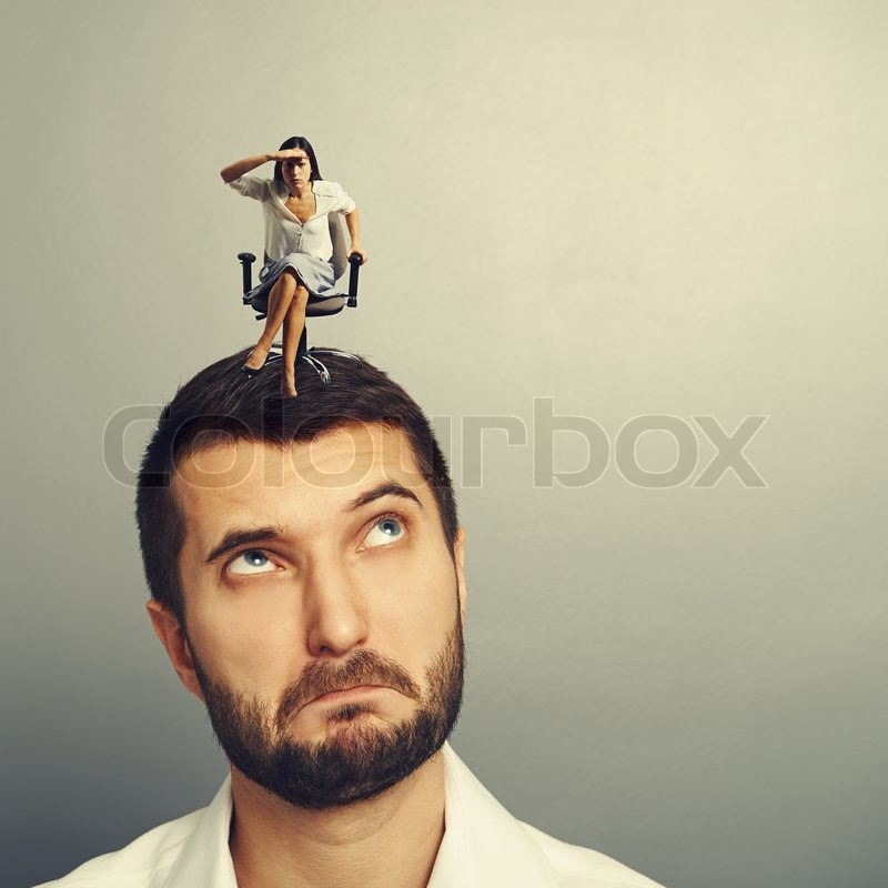 Stock image of 'serious woman sitting on the head and attentively peered  into the distance'