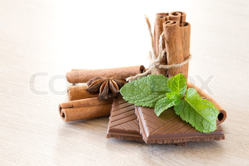 Stock image of 'Mint with cinnamon on wood background'