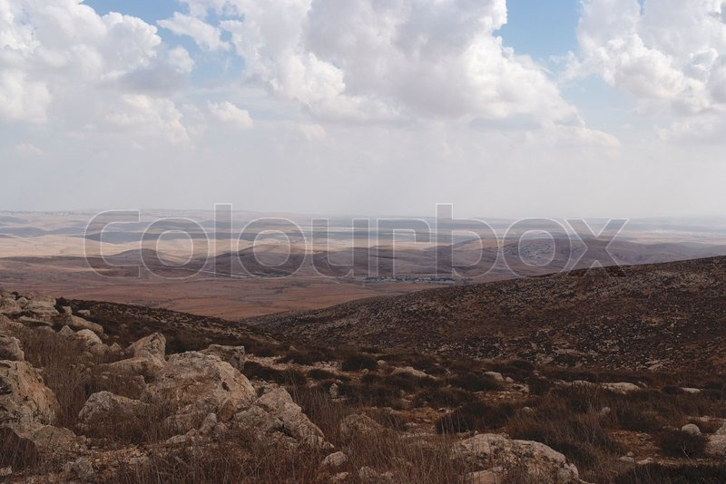Stock image of 'Southern slopes of Hebron mountain with Negev desert at the horizon'