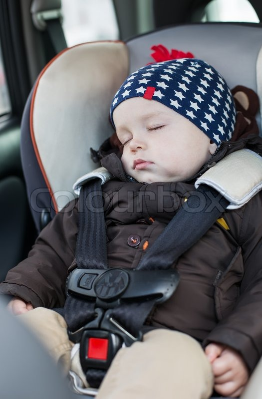 Stock image of 'cute baby boy sleeping in car seat'