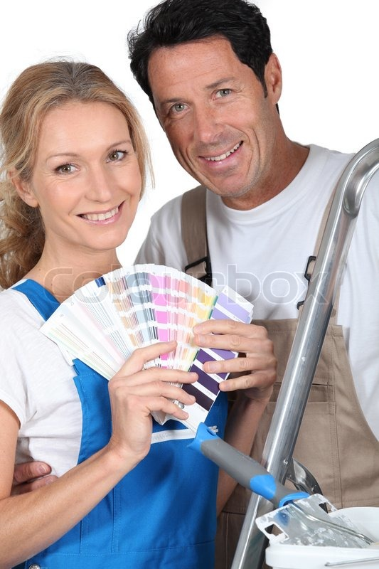 Stock image of 'Couple choosing colours'