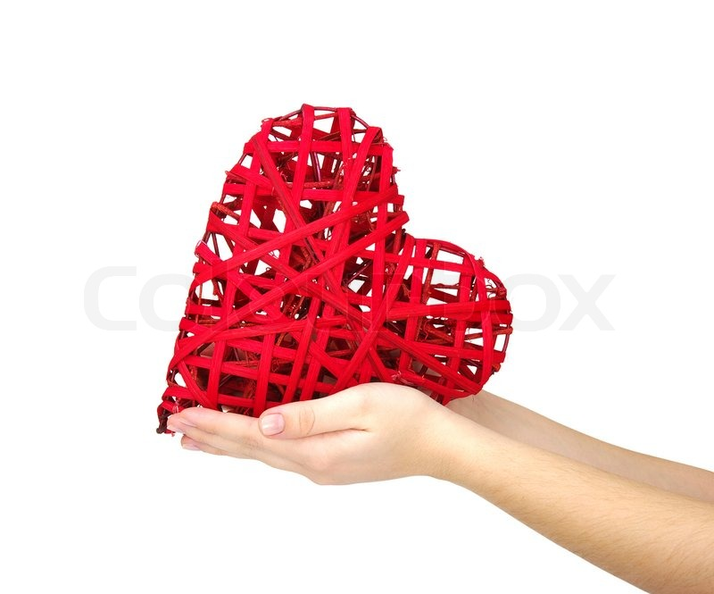 Stock image of 'Red heart in hand isolated on white '