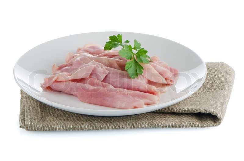 Stock image of 'Tasty slices of ham, on the round plate.'