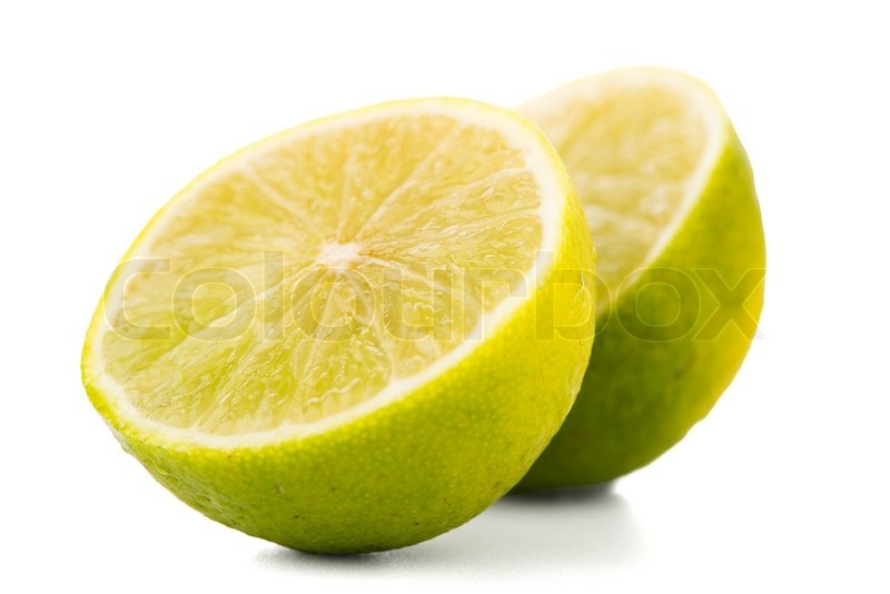 Stock image of 'Fresh green limes isolated on white background.'