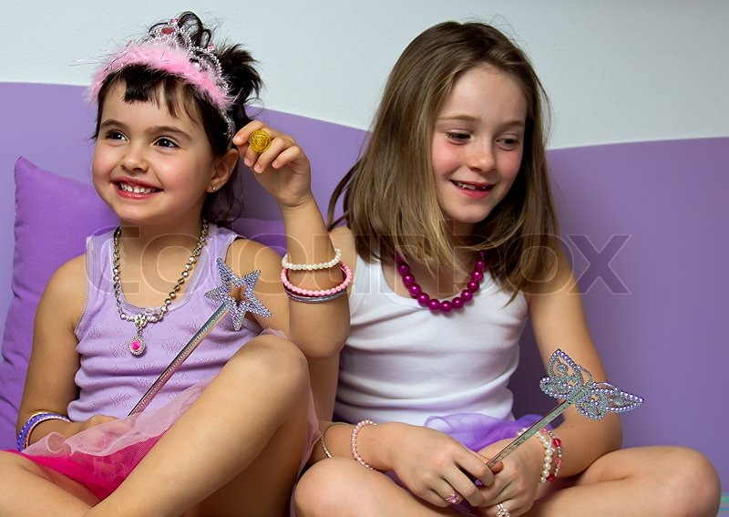 Stock image of 'Portrait of two little girls dressed in princess'
