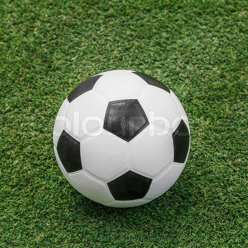Stock image of 'Close up soccer ball on green grass or artificial turf'