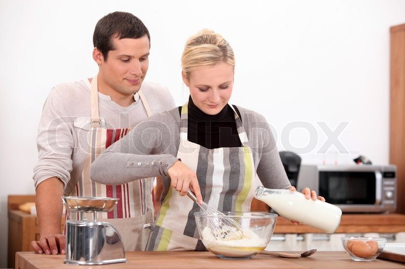 Stock image of 'Couple baking together'
