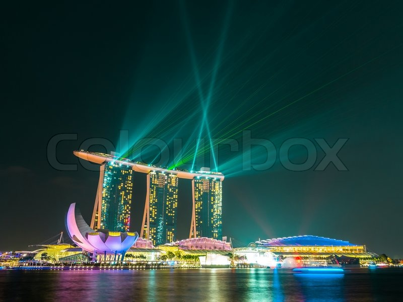 Stock image of 'Singapore city at night with laser show.'