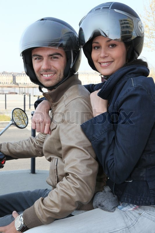 Stock image of 'Couple on a motorcycle'