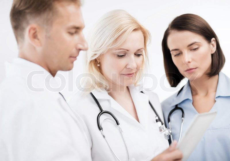Stock image of 'healthcare and technology concept - doctors looking at tablet pc'