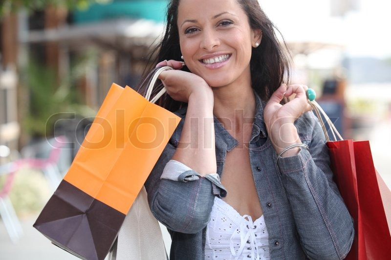 Stock image of 'Woman shopping in town'
