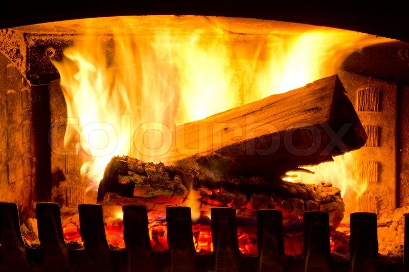 Fire place detail of a fire burning inside, stock photo