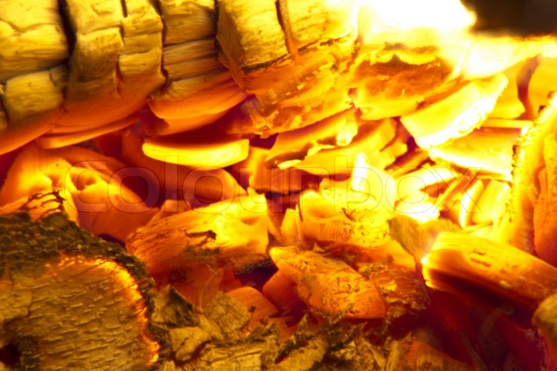 Stock image of 'Fire place detail of a fire burning inside.'