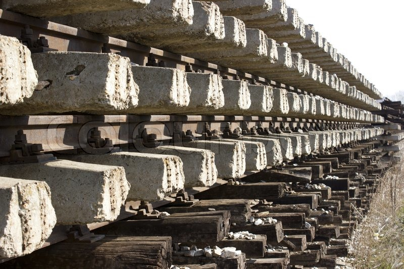 Stock image of 'Railroad metal train tracks shot at perspective view.'