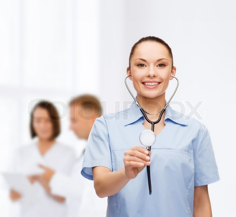 Stock image of 'healthcare and medicine concept - smiling female doctor or nurse with stethoscope'