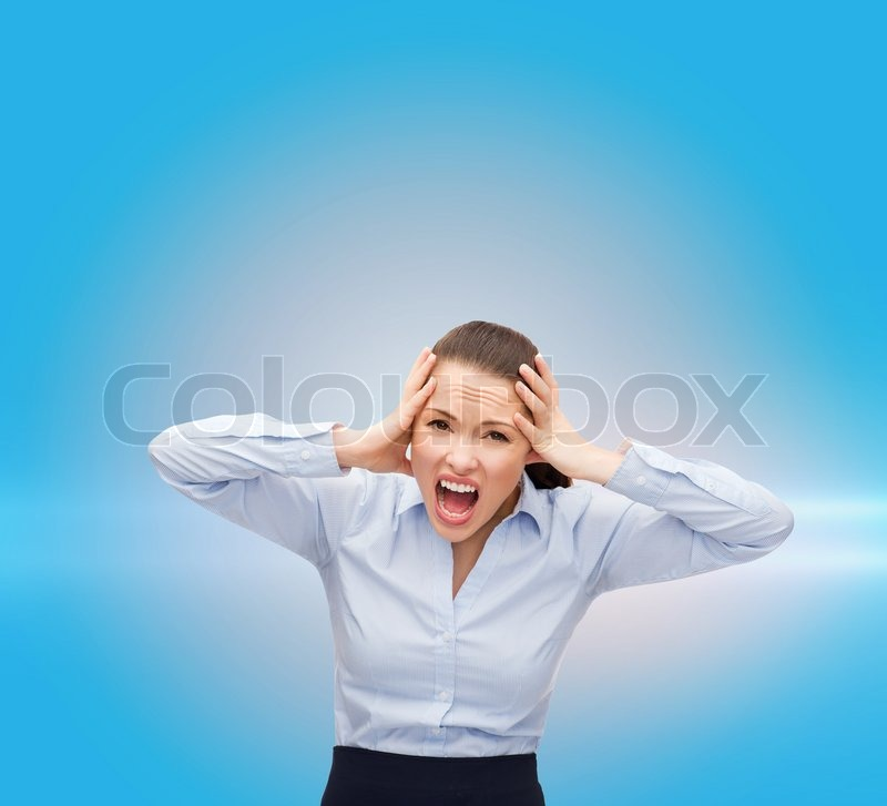 Stock image of 'business, office and stress concept - angry screaming businesswoman'