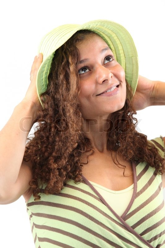 Stock image of 'Girl with curly hair in a summer hat'