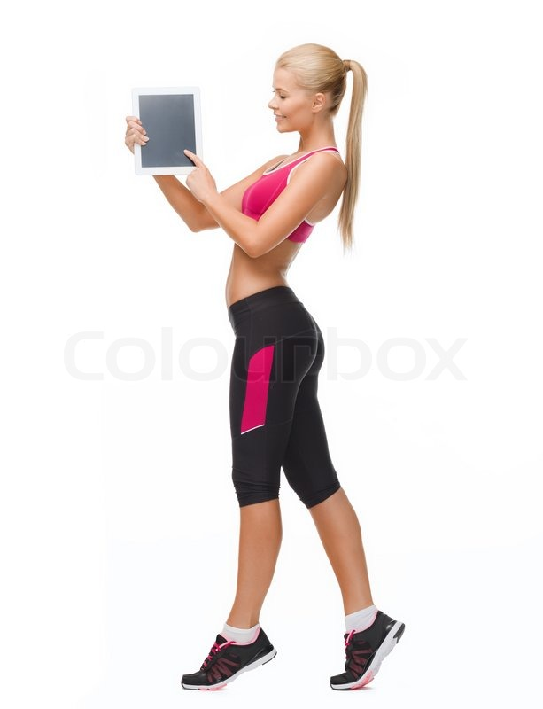 Stock image of 'fitness, dieting, technology and healthcare concept - sporty woman showing something on tablet pc screen'