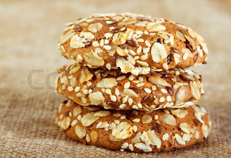 Stock image of 'homemade oatmeal cookies on baking with  nuts'